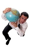 Weight of the World. Business man holding the weight of the world on his shoulder Stock Photography