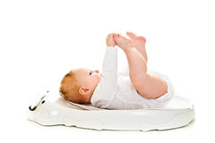 Weighting infant Stock Photo