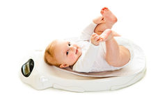 Weighting infant Royalty Free Stock Images