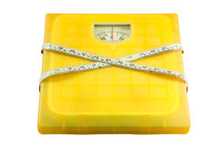 Weighting scales yellow Stock Images