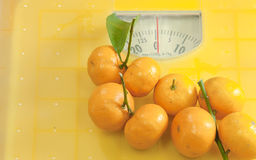 Weighting scales yellow Stock Photo
