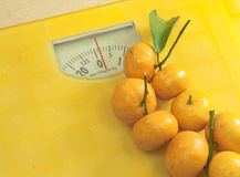 Weighting scales yellow Royalty Free Stock Photo