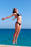 Weightless beautiful woman. Near the sea Royalty Free Stock Photography