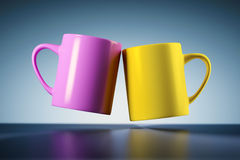 Weightless coffee mugs Stock Photo