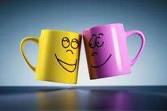 Weightless coffee mugs. An image of two weightless coffee mugs with faces Stock Photos