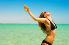 Weightless girl. Beautiful woman is enjoying sunlight Stock Image