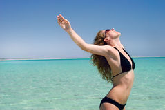 Weightless woman. Beautiful slim woman is enjoying the sea Stock Photography