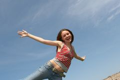 Weightlessness. Pretty young girl on a background of the blue sky Stock Images