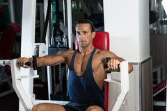 Weightlifter On Exercise Machine Stock Photo
