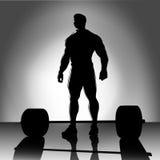 Weightlifter met barbellsilhouet Royalty-vrije Stock Foto's