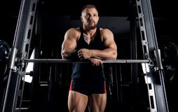 The weightlifter is near the bar. Put his hands on it for a respite Royalty Free Stock Images