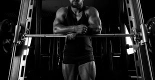 The weightlifter is near the bar. Put his hands on it for a respite Stock Photography