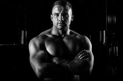 The weightlifter is posing in front of the camera with his arms stock photography