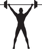 Weightlifter. A Silhouette of a weightlifter pressing weights Stock Photo