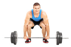 Weightlifting athlete lifting a barbell. Isolated on white background Stock Photography