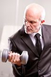 Weightlifting business man in action Stock Photo