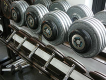 Weightlifting Dumbbells on a rack. Rack of weightlifting dumbells on a dumbell rack in a gym Royalty Free Stock Photo