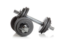 Weightlifting dumbbells on a white background Royalty Free Stock Photo