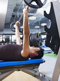 Weightlifting in gym. Man doing bench press in gym Stock Photos