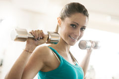 Weightlifting at gym Stock Image