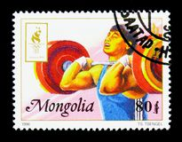 Weightlifting, Summer Olympics 1996, Atlanta serie, circa 1996. MOSCOW, RUSSIA - NOVEMBER 26, 2017: A stamp printed in Mongolia shows Weightlifting, Summer Royalty Free Stock Image