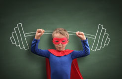 Weightlifting superhero boy. Concept for aspirations, achievement, exercising and fitness stock photo