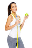Weightloss concept. Dieting woman with measuring tape and apple showing healthy eating and weightloss concept isolated on white Royalty Free Stock Images