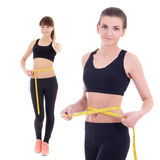 Weightloss concept - beautiful slim sporty women with measure ta Stock Photos