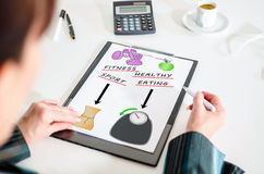 Weightloss concept on a clipboard. Woman looking at a weightloss concept Royalty Free Stock Image