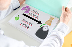 Weightloss concept on a paper. Man holding a file with weightloss concept Royalty Free Stock Image