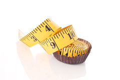 Weightloss Dessert. Weightloss With Diet Dessert Shown With Measuring Tape In Candy Wrapper Stock Photo