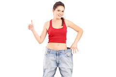 A weightloss girl giving a thumb up Royalty Free Stock Photography