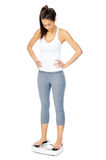 Weightloss scale woman. Woman with scale celebrating weightloss and a healthy fit body Stock Photo
