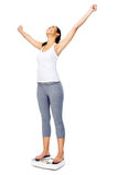 Weightloss scalekvinna Arkivbilder