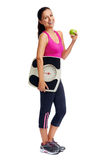 Weightloss woman. Healthy diet eating woman with scale and apple for weightloss Royalty Free Stock Photo