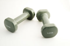Weights. Two small female weights for sport Royalty Free Stock Photos