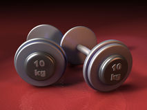 Weights. Two 10 kgs weights over a red background. CG illustration royalty free illustration