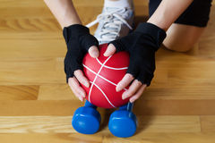 Weights being picked up off of Gym Wooden Floor Royalty Free Stock Image
