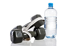 Weights, botte of water and measure tape. Isolate on white background Stock Photo