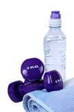 Weights with bottled water Royalty Free Stock Images