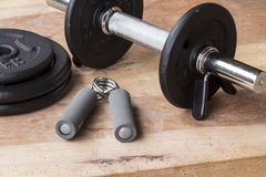 Weights and dumbbell set for fitness  on a wooden background Royalty Free Stock Photography