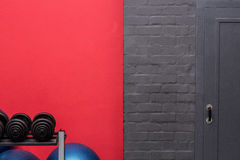 Weights and exercise balls in front of a wall Royalty Free Stock Images