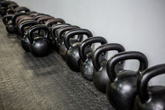 Weights lined at the wall Stock Images