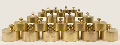 Weights made from brass Stock Photos