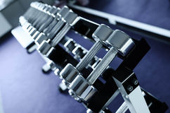 Weights, many silver dumbbell in fitness room Stock Photo
