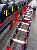 Weights and Measures. Row of weights of various measures at fitness center Stock Photo
