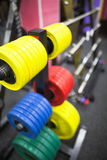 Weights for powerlifting. Colourful weights for powerlifting on a rack Royalty Free Stock Images