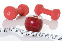 Weights, Red Apple, And Measuring Tape Royalty Free Stock Photography