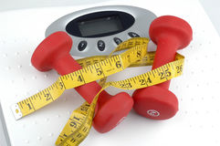 Weights and Scale. Weights on top of a weight scale Stock Photography