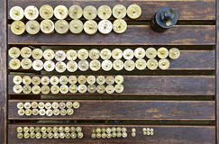 Weights on a wooden table Stock Images